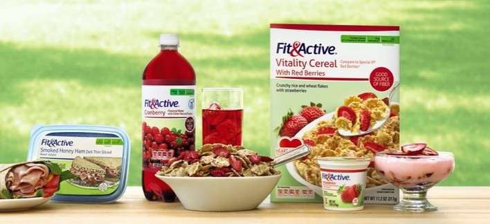 Various Fit & Active Products on picnic table in grass.